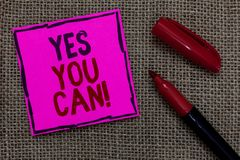 Word writing text Yes You Can. Business concept for Positivity Encouragement Persuade Dare Confidence Uphold Pink paper Important. Reminder Marker Communicate royalty free stock images