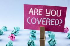 Word writing text Are You Covered Question. Business concept for Health insurance coverage disaster recovery written on Pink Stick. Word writing text Are You Royalty Free Stock Images
