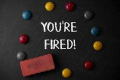 Word writing text You Re Fired. Business concept for Used by boss indicate employee that he is discharged from job Round. Word writing text You Re Fired royalty free stock image