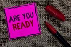 Word writing text Are You Ready. Business concept for Alertness Preparedness Urgency Game Start Hurry Wide awake Pink paper Import. Ant reminder Marker stock images
