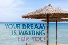 Word writing text Your Dream Is Waiting For You. Business concept for Goal Objective Intention Target Yearning Plan Blue beach wat royalty free stock image