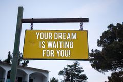 Word writing text Your Dream Is Waiting For You. Business concept for Goal Objective Intention Target Yearning Plan Wooden board h. Ang hanging post ideas Stock Image
