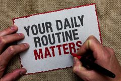 Word writing text Your Daily Routine Matters.. Business concept for Have good habits to live a healthy life On jute ground human h. And written some texts on red stock image