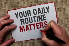 Word writing text Your Daily Routine Matters. Business concept for Have good habits to live a healthy life On jute ground human ha. Nd written some texts on red stock images
