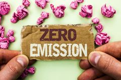 Word writing text Zero Emission. Business concept for Engine Motor Energy Source that emits no waste products written on Tear Card. Word writing text Zero Stock Photo