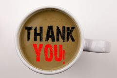 Word, writing Thank You text in coffee in cup. Business concept for Giving Gratitude Appreciate Message on white background with c Stock Photography