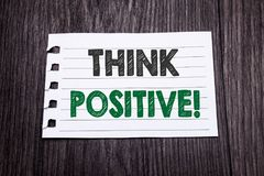 Word, writing Think Positive. Business concept for Positivity Attitude written on sticky note paper on the dark wooden background. Word, writing Think Positive stock photo