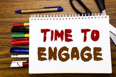 Word, writing Time To Engage. Business concept for Engagement Involvement Written on notebook, wooden background with office equip. Word, writing Time To Engage Stock Photo