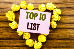 Word, writing Top 10 Ten List. Business concept for Success ten list written on sticky note paper on the wooden background. Word, writing Top 10 Ten List Stock Photo