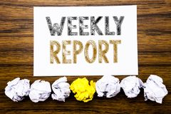 Word, writing Weekly Report. Concept for Analyzing Performance  Written on sticky note paper reminder, wooden background with stic. Word, writing Weekly Report Royalty Free Stock Image