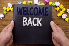 Word, writing Welcome Back. Business concept for Emotion Greeting written on notepad notebook book on the wooden wood background w. Word, writing Welcome Back Royalty Free Stock Photo