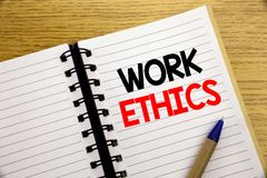 Word, writing Work Ethics. Business concept for Moral Benefit Principles written on notepad with copy space on old wood wooden bac. Word, writing Work Ethics Stock Photos