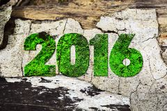 The word 2016 written in rusty metal letterpress type sitting on a wooden ledge background. The word 2016 written in rusty metal letterpress type sitting on a Royalty Free Stock Photo