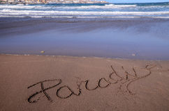 Word Written on the Sand. Of a Tropical beach Stock Photo