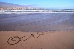 Word Written on the Sand Stock Photo