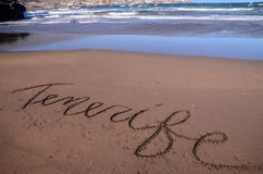 Word Written on the Sand. Of a Tropical beach Stock Photos