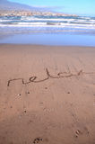 Word Written on the Sand. Of a Tropical beach Royalty Free Stock Images