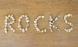 Word written with white rocks. Word Rocks written with white rocks Stock Image