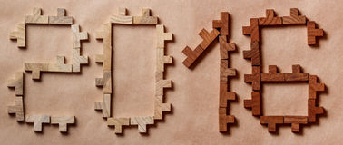 Word written with wooden bricks on brown background Royalty Free Stock Photo