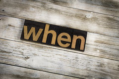 When Letterpress Word on Wooden Background. The word `when` written in wooden letterpress type on a white washed old wooden boards background stock photo