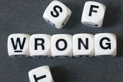Word wrong on toy cubes. Word wrong on white toy cubes Stock Photo