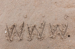The word www handwritten in sand Royalty Free Stock Image