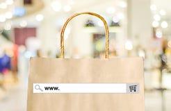 Word www op onderzoeksbar over het winkelen zak en backgro van de onduidelijk beeldopslag Stock Afbeeldingen