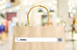 Word www. on search bar over shopping bag and blur store backgro Stock Images