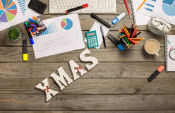 Word xmas with charts and office objects on wooden desk Stock Photo