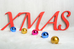 Word XMAS and Christmas toys Royalty Free Stock Photos