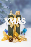The word Xmas hanging over green Christmas presents Stock Photography