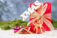 The word Xmas hanging over red Christmas presents Stock Photography