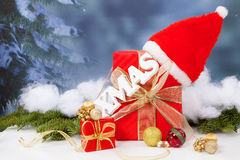 The word Xmas hanging over red Christmas presents. The word Xmas hanging over red Christmas present Royalty Free Stock Photo