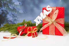 The word Xmas hanging over red Christmas presents Stock Photo