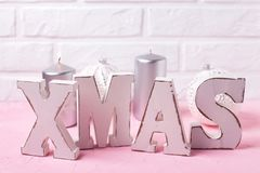 Word Xmas made from wooden letters, silver candles and balls on Stock Images
