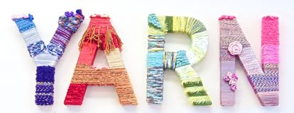 The word. Yard created with brightly coloured knitting yard Stock Photos