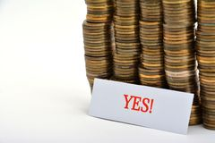 Word yes with coins isolated on white. Background royalty free stock image