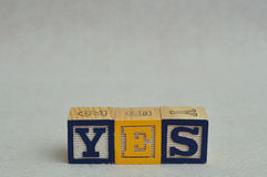 The word yes spelled with colorful alphabet blocks Stock Image