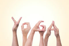 The word yoga in front of yellow and white Stock Photo