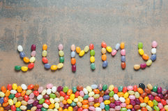 Word yummy written with jelly beans Stock Images