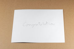 Wording Congratulation of white envelope on brown background Stock Image