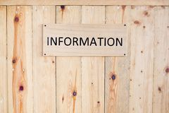 Wording Information sign on wood board. Royalty Free Stock Images