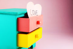 Wording, Love. On pink heart paper note. In drawer vintage wood box Royalty Free Stock Images