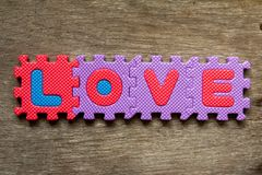 Wording love place on wood background for valentine. Wording love place on wooden background for valentine Stock Photo