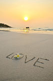 Wording love in sand Royalty Free Stock Images