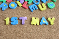 Wording 1st may on cork board Royalty Free Stock Photo