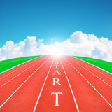 Wording START on running track in blue sky and clouds Royalty Free Stock Image