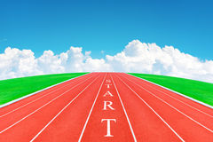 Wording START on running track in blue sky and clouds Stock Photo