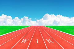 Wording WIN on running track in blue sky and clouds Stock Photography