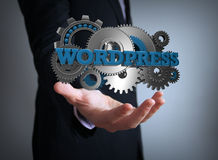 Wordpress gears businessman Royalty Free Stock Image